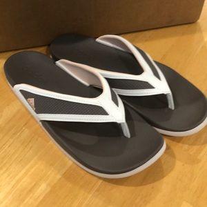 NWOT Adidas flip flops.